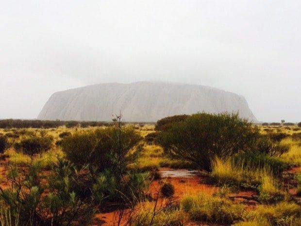 Uluru in a rare rainstorm